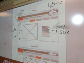 The whiteboard in the Mac Lab, with student work displayed.